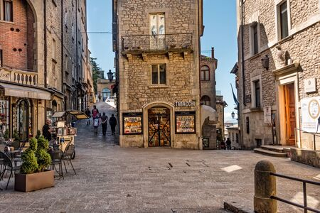 San Marino, Republic of San Marino - June 15, 2016:  Tourists stroll through the small shopping village and town square in the Republic of San Marino