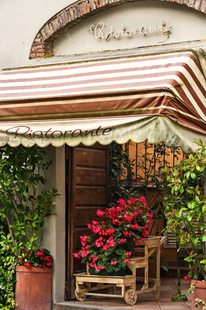 Outside fascade of Italian restaurant in the city of Pisa, Italy.