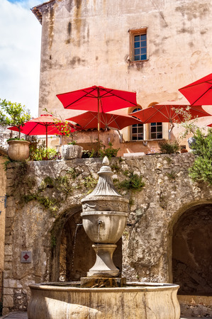 vence: Historic building with fountain in the old village St. Paul-de-Vence. Stock Photo