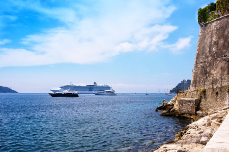 deepest: Nice, France - June 8, 2016: Cruise ships and yachts anchored in harbour on Villefranche-sur-Mer.  The bay is one of the deepest natural harbours in the Mediterranean Sea and makes it possible for large cruise ships to have a safe anchorage.