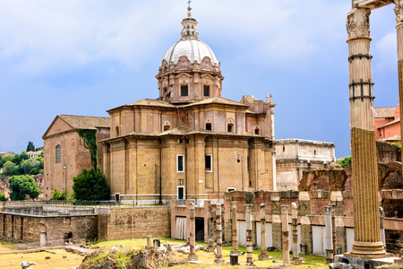 history building: The ancient ruins of the once Roman Forum, surrounded by other ancient govermental buildings.
