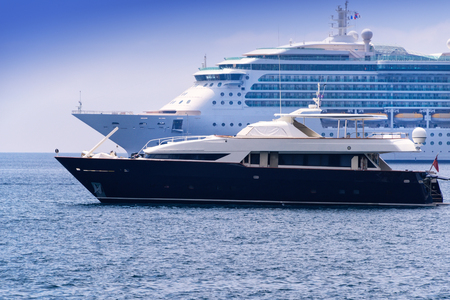 water transportation: Cruise ship and yacht anchored in a harbor in Nice, France. Stock Photo