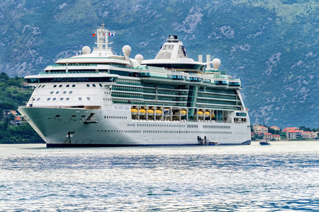 Kotor, Montenegro - June 16, 2016:  Cruise ship anchored in the harbor in Kotor.  Water taxis transport passengers to and from land.