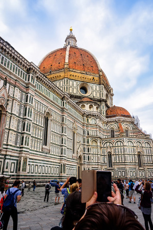 cattedrale: Florence, Italy - June 9, 2016:  Tourists taking pictures of the Cattedrale di Santa Maria del Fiore (St. Mary of the Flower) in the Piazza del Duomo. Editorial