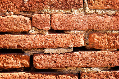 Horizontal bricks in a wall, provide a structural background