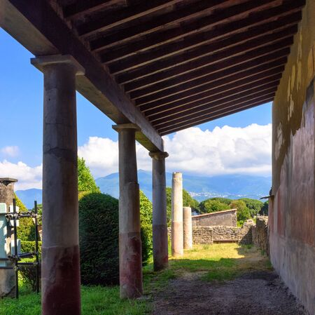 Ruins in Pompeii, Italy with mountains in the background Stock Photo