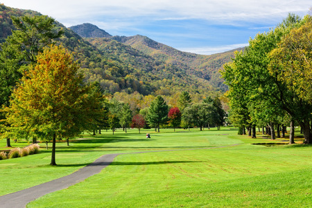 Beautiful golf course fairway in the mountains during the season of Fall