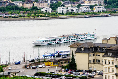 River boat on the Rhine River as it approaches the village of Rudesheim in Germany. Banco de Imagens