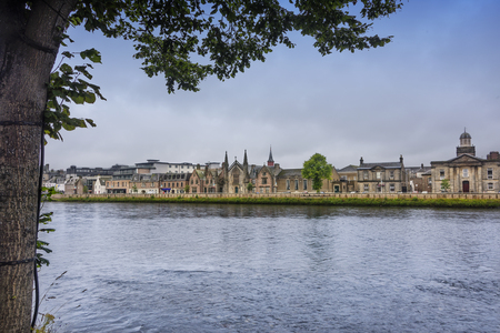 The River Ness, as it runs through the city of Inverness, the cultural capital of the Scottish Highlands. Stock Photo