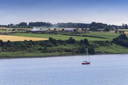 Small sailboat on the Moray Firth near Inveness, Scotland. Stock Photo