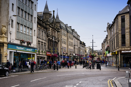 Inverness, Scotland - August 13, 2018:  Busy street filled with pedestrians in the city of Inverness, Scotland. Editorial