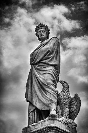 Florence, Italy - June 9, 2016:  The statue of Dante Alighieri in Santa Croce square in Florence, Italy.  In Black and White. Editorial