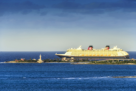 Nassau, Bahamas - March 3, 2018:  Disney Cruise Ship departing the port of Nassau in the Bahamas.