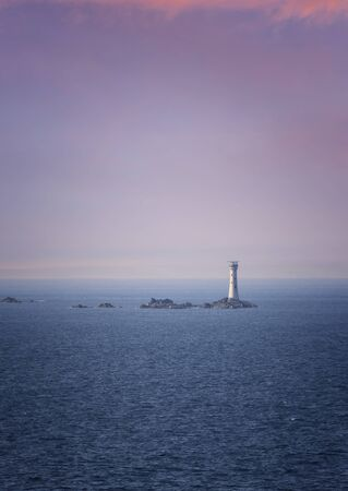 Les Hanois Lighthouse in Guernsey, British Isles Imagens