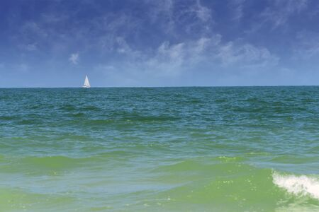 Sailboat on the horizon, sailing on the Gulf of Mexico in Clearwater, Florida