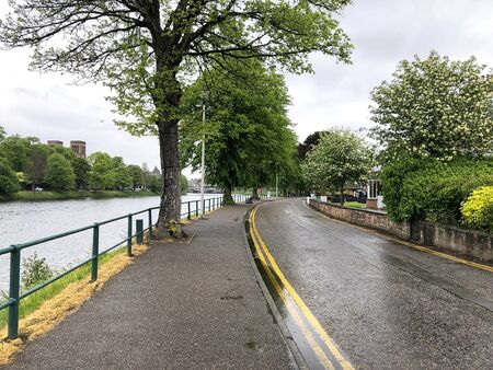 Narrow street running along side the Ness River in Inverness,  Scotland Imagens