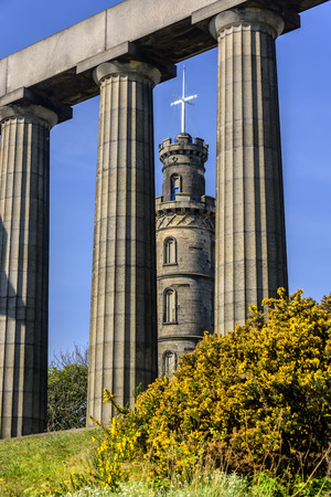 The Nelson Monument, seen through the pillars of the National Monument on Calton Hill, Edinburgh.
