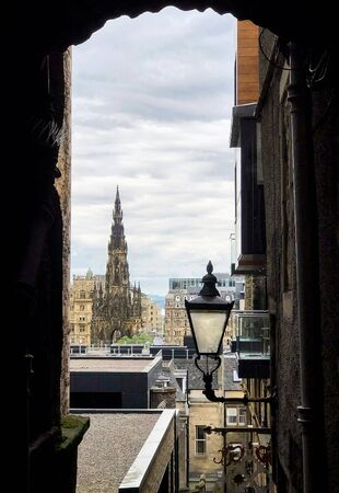 One of many closes, or alleyway, in the city of Edinburgh with a view of the Scott Monument.