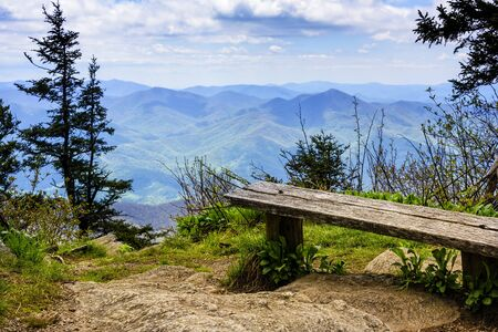Scenic view from wooden bench of Smoky and Blue Ridge Mountains in North Carolina