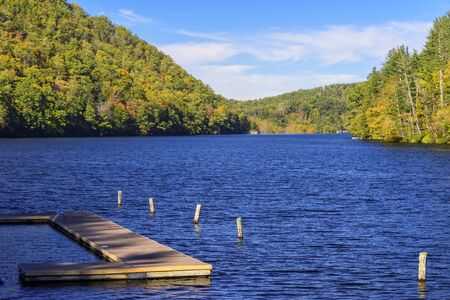 Large lake with dock in the Autumn season in the mountains of North Carolina Imagens