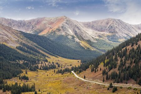 Road leading to Independence Pass in Colorado with beautiful mountain range