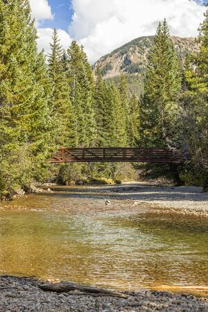 Small bridge over running stream in the Colorado mountains