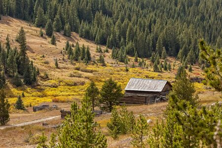 Abandoned farm in the rural mountain range and autumn landscape