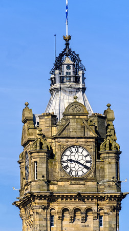 The clock atop The Balmoral Hotel in Edinburgh, Scotland Editorial
