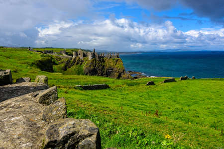The structural remains of the ruined Dunluce Castle in Northern Ireland