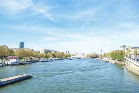 docking: Canal of Paris with boats and buildings summertime Stock Photo