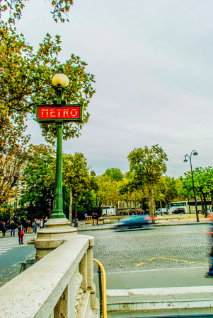 Metro station sign in a Beautiful street in Paris
