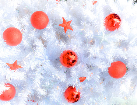 Snow white christmas tree with decoration in red Stock Photo