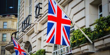 jack of diamonds: UK flag on London building street Stock Photo