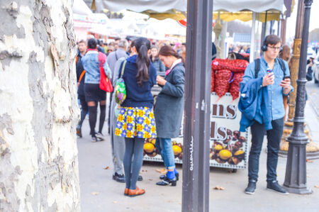 Christmas market on the Boulevard champes elysee in Paris, with people Editorial