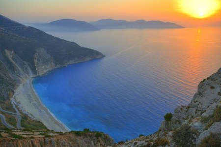 Sunset over the beautiful beach of Myrtos, Kefalonia, Greece