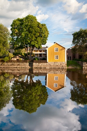 A photo of a reflection on a house near Arboga river, Sweden Editorial