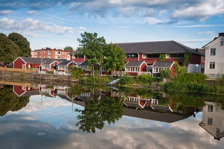 Some houses near the Arboga river, Sweden Stock Photo - 10023447