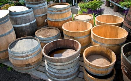 Some wooden barrels standing outside