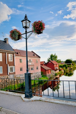 A lamppost over the water in Arboga, Sweden Stock Photo - 10100989