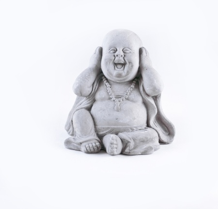 smiling buddha: A small statue isolated on a white background