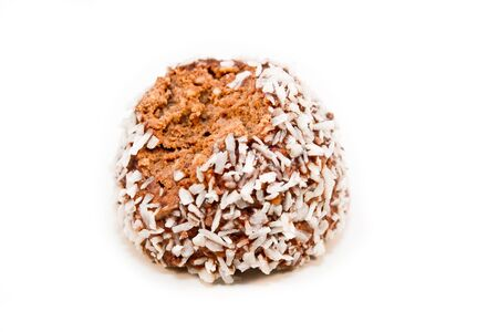 A half eaten chocolate ball isolated on a white background