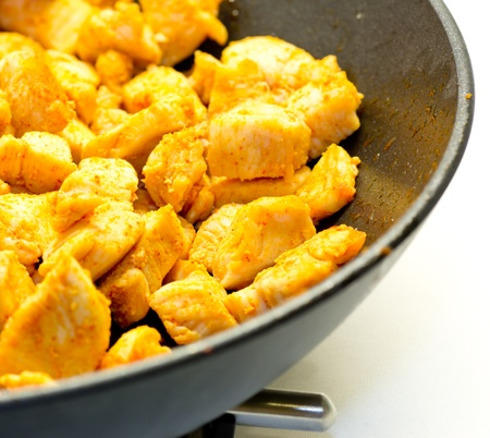 Chicken fried in a frying pan Stock Photo