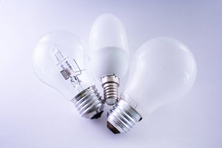 Generation shift of lamp bulbs on white background photo