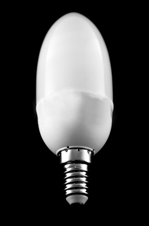 A low energy light bulb isolated on black background