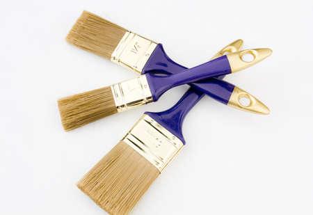 Three unused paintbrushes isolated on white background Stock Photo