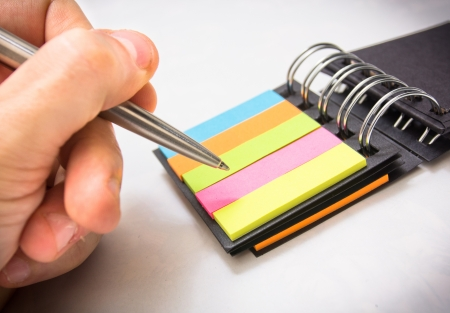 Pen writing on color note Stock Photo