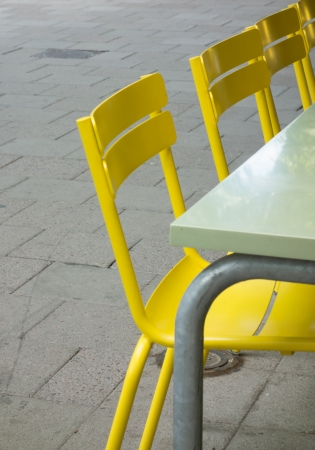 Some yellow chairs on a cafe Stock Photo