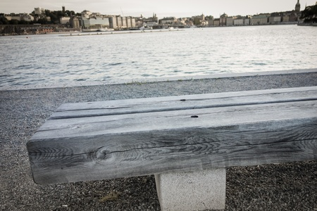 A wooden bench near the water in Stockholm