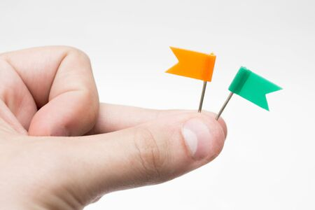 Hand holding two coloured mini flags Stock Photo