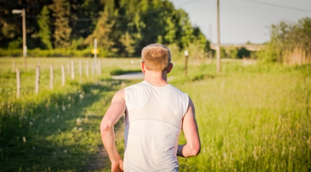 A man running away from the camera Stock Photo